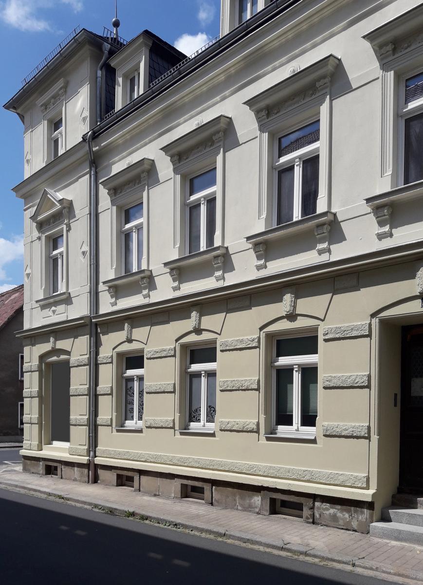 Fassadenputz an denkmalgeschütztem Mehrfamilienhaus